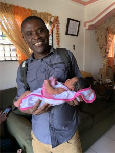 Dr. Lawrence with his new daughter